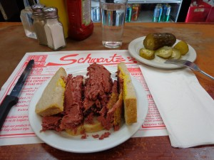 smoked meat on rye with a pickle at Swartz's deli