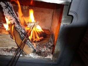 Charring ginger in the wood stove.